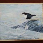 Fågel på klippa i havet